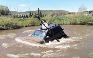 "Steamboat Springs' Shirley Boozin completed an arresting routine to win the first SUV River Rodeo in the Yampa River's turbulent ""A"" Hole."