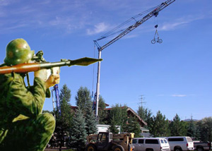 A Routt County crane hunter, complete in camouflage gear, lines up a shot for his licensed harvesting of a Rocky Mountain Construction Crane.
